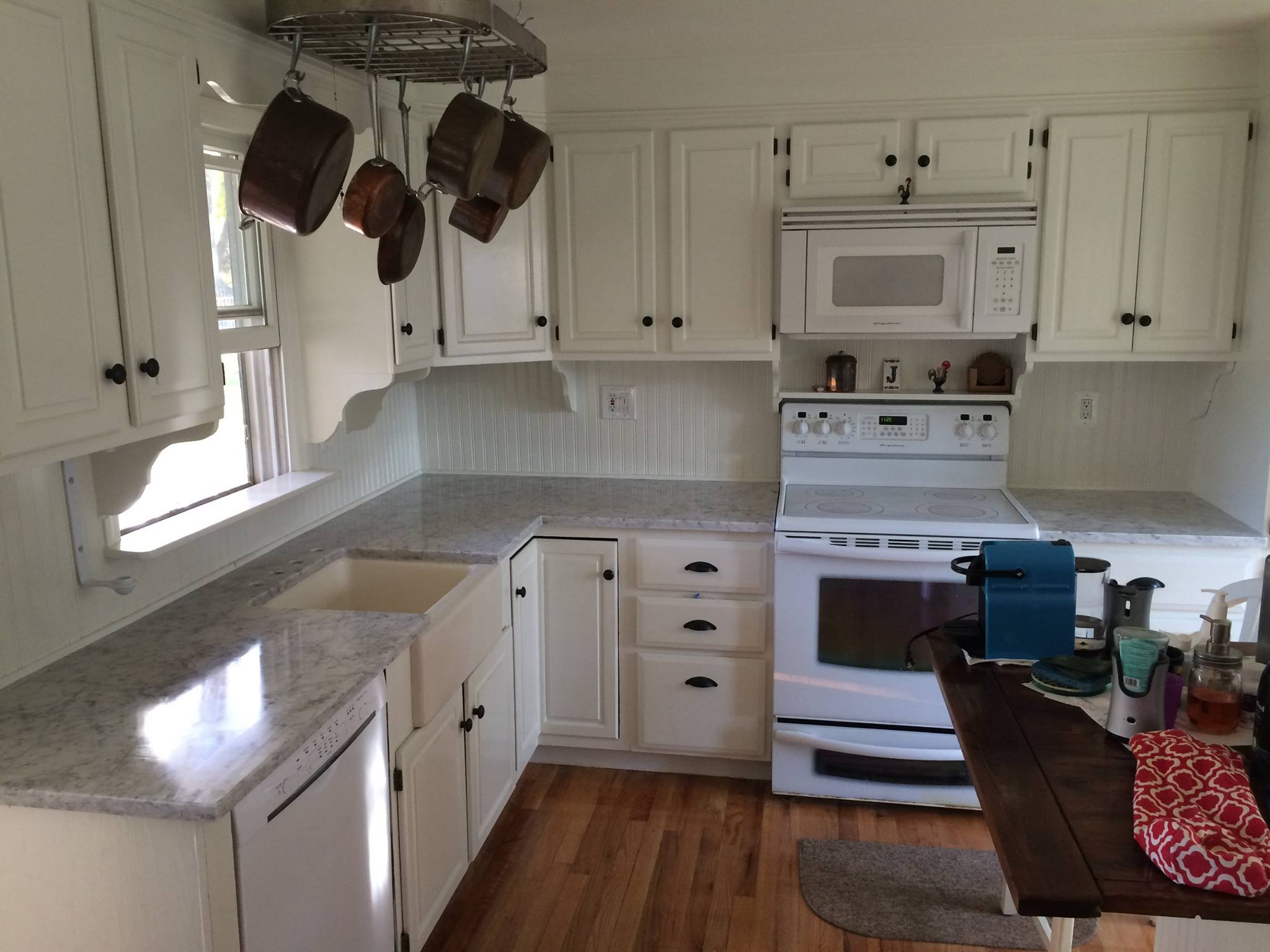 long island NY white countertops and cabinets farmers sink